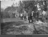 Students walking toward Old Main, North Dakota Agricultural College
