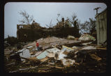 Young girl on her homes wreckage, 1957 Fargo, N.D. tornado