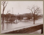 Northern Pacific Railroad bridge during flood of 1897, Fargo, N.D. and Moorhead, Minn.