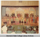 Actors on stage during Bismarck Junior College production of The King and I, Bismarck, N.D.