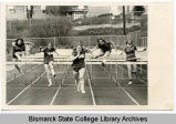Members of Bismarck Junior College women's track team jump hurdles, Bismarck, N.D.