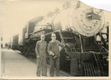 Irwin Neros and Frank Stowell in front of train, Enderlin, N.D.