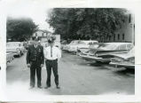 Police Chief Erbstoesser and Officer Finzel in parking lot, Enderlin, N.D.