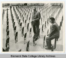 Installation of the seats in the Sidney J. Lee Auditorium at Bismarck Junior College, Bismarck, N.D.