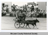 Dog cart in parade, Max, N.D.