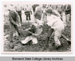Wrestling in the mud with a pig, Bismarck, N.D.