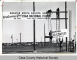 1964 National Plowing Contest billboard, Wheatland, N.D.