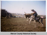 Joe Gustafson riding a bull, Mercer County, N.D.