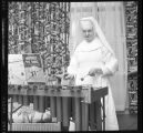 Nun playing a marimba at St. Ansgar Hospital, Moorhead, Minn.