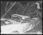 Wrecked automobile belonging to Jerry Davenport, taken after 1957 tornado, Fargo, N.D.