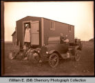 Family outside cook car, Williston, N.D.