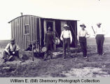 Homesteaders outside house, Barr Butte township, N.D.