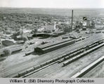 Great Northern Railway yards with arrow pointing to the Silver Grille Cafe aerial photograph, Williston,