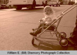 Williston's 25th Anniversary of Oil Discovery Celebration, girl in stroller, N.D.