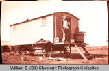 Man standing in cook car, N.D.