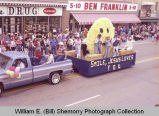 "Band Day parade 1983, ""Jesus loves you"" float, Williston, N.D."