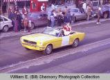 Williston Christmas parade 1983, girl in automobile, N.D.