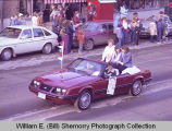 Williston Christmas parade 1983, women in automobile, N.D.