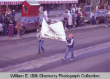 Williston Christmas parade 1983, AMINOIL banner, N.D.
