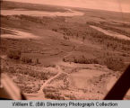 Flooded oil well on Beaver Creek near Ferry Landing aerial photograph, N.D.
