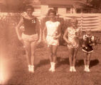 Band day 1950s, baton twirlers with trophies, Williston, N.D.