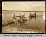 Boat coming to shore, Willow Lake, Wildrose, N.D.