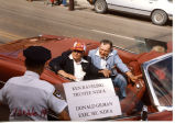 Ken Raveling and Donald Gilman of the NDFA in a parade in Williston, N.D.