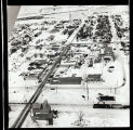 Aerial view overlooking a town, railroad tracks and grain elevator, N.D.
