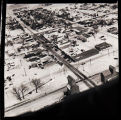 Aerial view overlooking a town, railroad tracks and grain elevators, N.D.