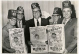 Men wearing Shrine hats with Shrine Circus posters, Williston, N.D.