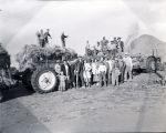 Men, women and boys threshing hay, N.D.