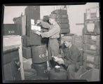 Two soldiers with Company E supplies, Fort Rucker, Alabama