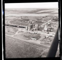 Aerial view of grain elevators and Great Northern railroad cars, Grenora, N.D.