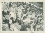 Crowd in grandstand watching horse race at Wells County Fair, Fessenden, N.D.