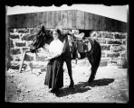 Hilda Banning standing by her pony, Flasher, N.D.