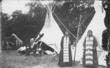Two Native American women standing in front of tipi, Fort Totten, N.D.