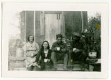 Group on steps of cook shack at the sawmill south of Sanish, N.D.