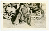 Ed Stolson by his cat down at his sawmill south of Sanish, N.D.