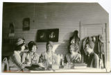 Group of young women inside Thorpe's Place, Sanish, N.D.