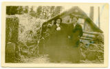 Dan Adams and unidentified man in front of log cabin, Sanish, N.D.