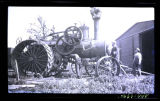 Men with steam powered tractor