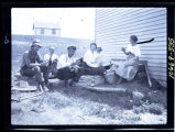 Group having picnic lunch on farm, Walsh County, N.D.
