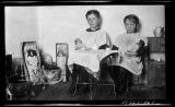Two girls with their dolls inside house, Walsh County, N.D.