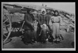 German Russian women and children in front of sod house, Dunn County, N.D.
