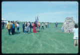 Color guard and crowd at monument Arikara Indian Scout Cemetery, White Shield, N.D.
