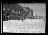 Snow drifts in front of Cole's Store after snowstorm, Kenmare, N.D.