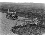 Disking with Caterpillar tractor