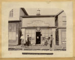 Men and child outside George Thompson Grocery Store, Pembina, N.D.