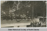 Theodore Roosevelt on platform speaking to crowd at Fargo College Library cornerstone laying...