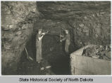 Digging coal with pick ax and shovel at face of vein, Wilton, N.D.